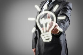 man in suit behind lightbulb sketch