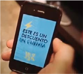 hand holding smartphone-spanish phrase on screen