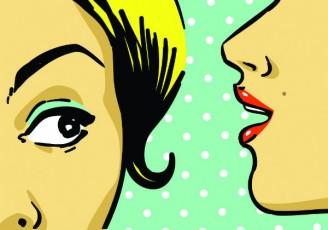 woman whispering in woman's ear