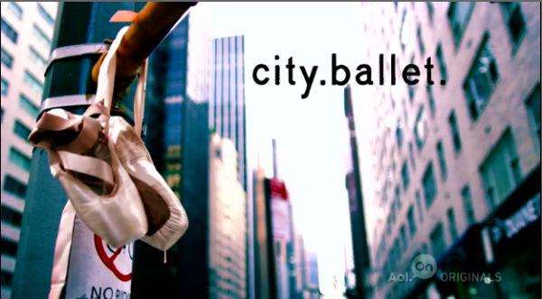 hanging ballet shoes-railing-city background