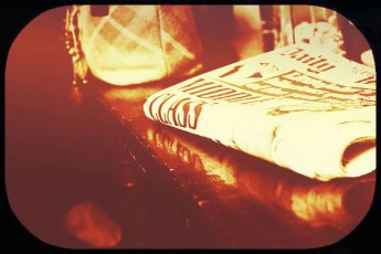folded newspaper-sepia image
