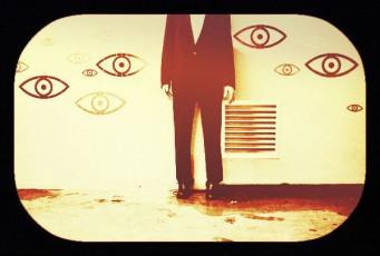 eyes-headless guy standing against wall