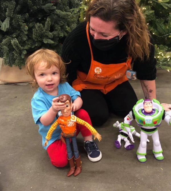 Image showing Wood's 2-year-old owner, a Home Depot employee and Buzz Lightyear.