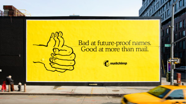 Image by Mailchimp that shows a billboard using the color yellow to stand out from the crowd.