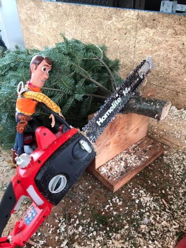 Image showing Toy Story's Woody operating a chain saw in a Home Depot Store.