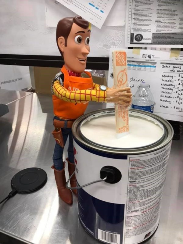 Image showing Toy Story's Woody stirring paint in a Home Depot Store