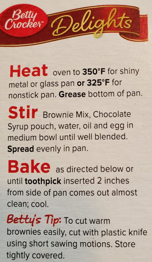 An image of the side of a Betty Crocker brownie mix box showing Betty's Tip to use a plastic knife to slice through the warm baked goods.
